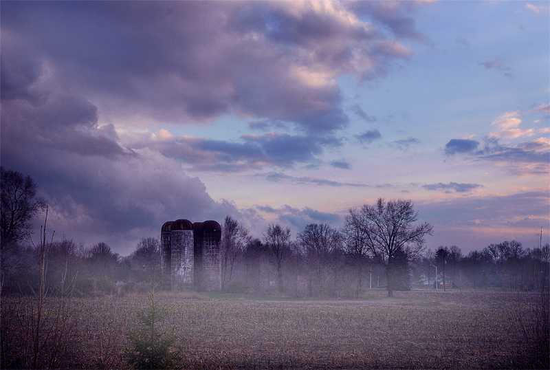 Silos With A Light Fog