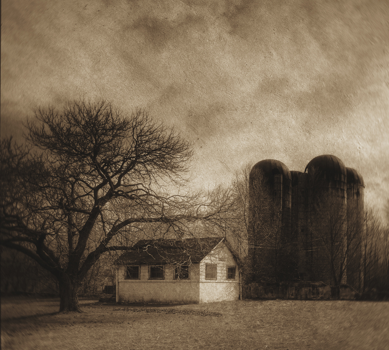 Tool Shed And Silos In Late Winter